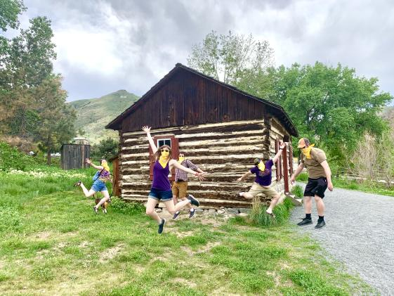 Tour Group Celebrates at Reynolds Cabin