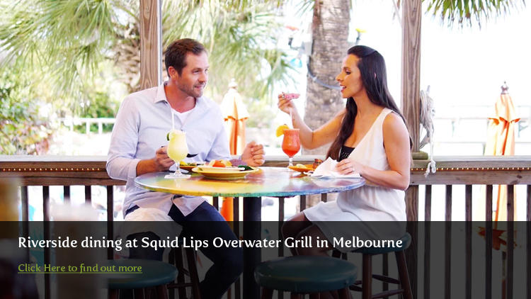 Couple enjoying riverside dining at Squid Lips in Melbourne
