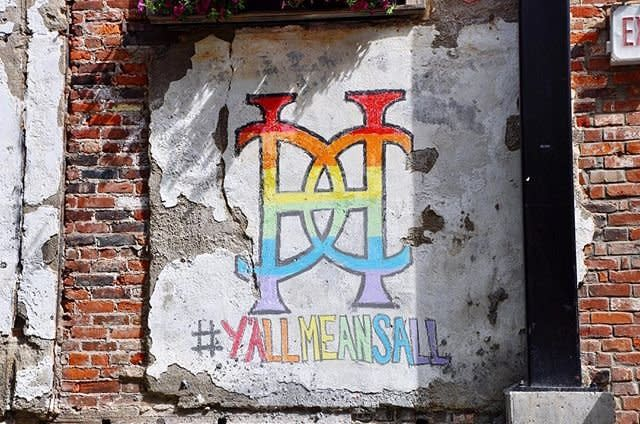 A rainbow colored chalk sign at Hotel Covington that reads #yallmeansall
