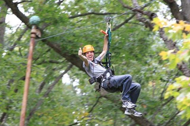 Man Zipping Through Trees
