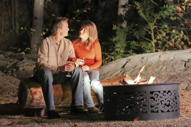 Couple Sitting by Fire with Wine