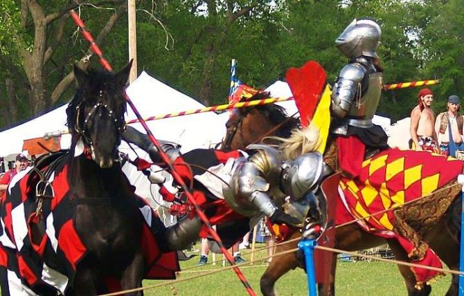 A knight is jousted off his horse at the Renaissance Faire in Wichita