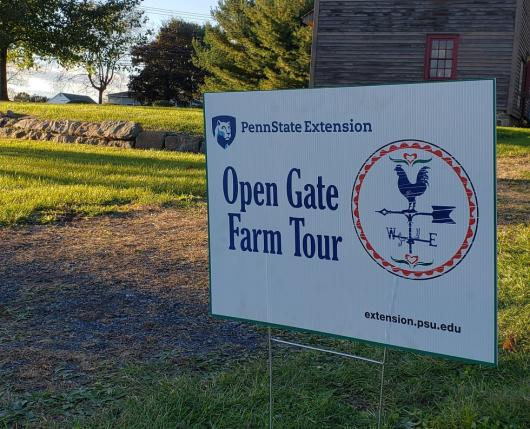 Open Gate sign outside of barn building