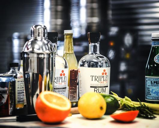 Triple Sun Bottles on the bar