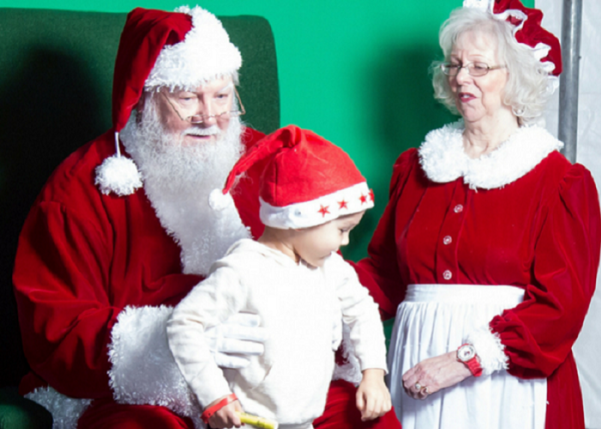Taking a photo with Santa and Mrs. Claus