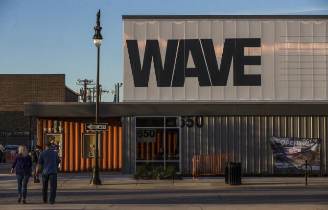 A couple approach WAVE venue in Wichita at dusk to attend a live concert