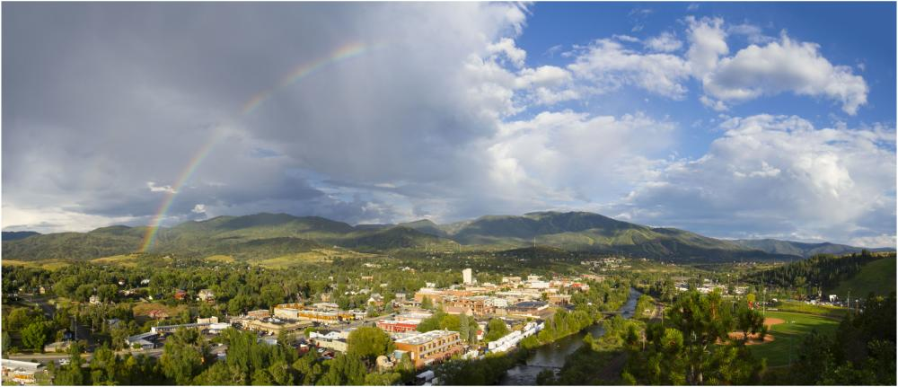 a rainbow fills the sky over downtown Steamboat Springs