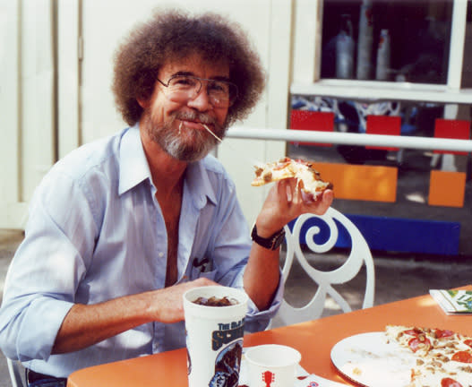 Bob Ross eating pizza