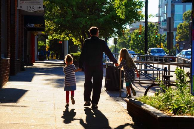 Dad and Kids walking down Franklin Street