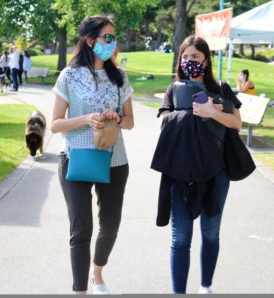 Two women walking in Marina Park at the Kirkland Wednesday Market