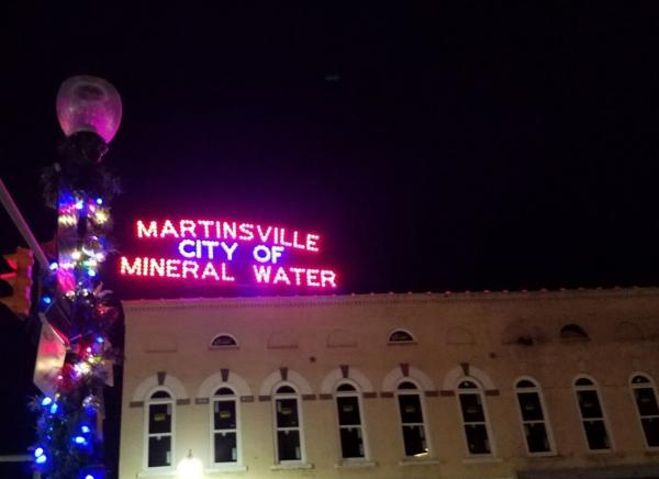 The historic City of Mineral Water sign joins holiday decorations in lighting up downtown Martinsville.