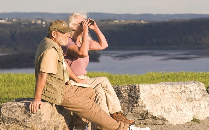 Couple With Binoculars Taking In Views of The Highpoint in York, PA