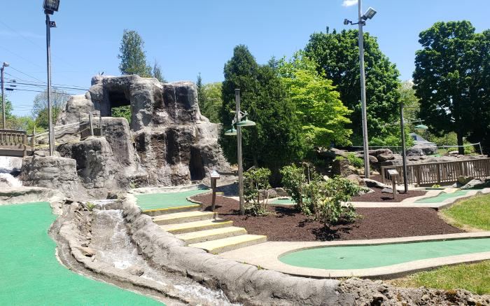 Two Miniature Golf Courses surrounded by waterfalls, streams, and trees. Fun for the whole family!
