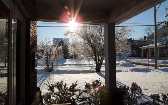Front Porch looking toward Hartzell House B & B (an optional breakfast is available at the B & B)