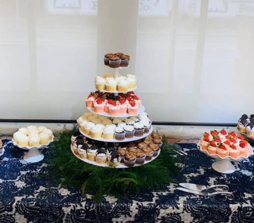 A tower of cupcakes in varying flavors from the home-based Dayton bakery Kia Cake & Company.