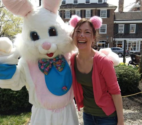 A woman poses with the Easter Bunny