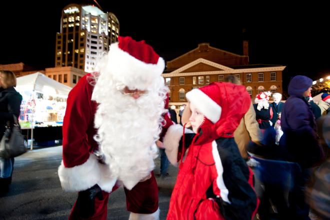Santa talking to a child at Dickens of a Christmas in downtown Roanoke