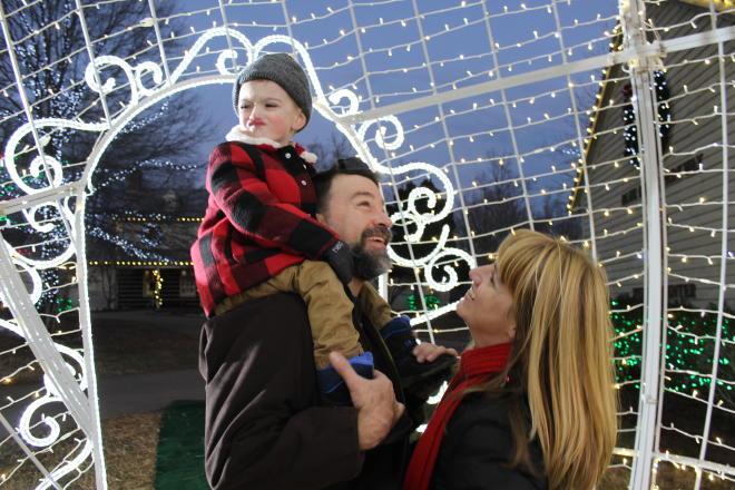 A family enjoying an Illuminights display at Explore Park, Roanoke County