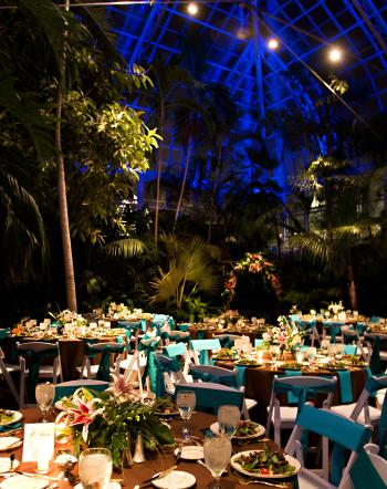 Franklin Park Conservatory Palm House at night filled with dining tables