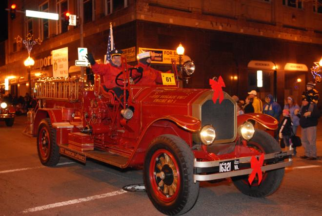 Historical fire truck riding in the Dickens of a Christmas Parade