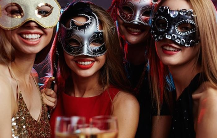 Masked women on Odyssey Masquerade Fireworks Dinner Cruise in Chicago