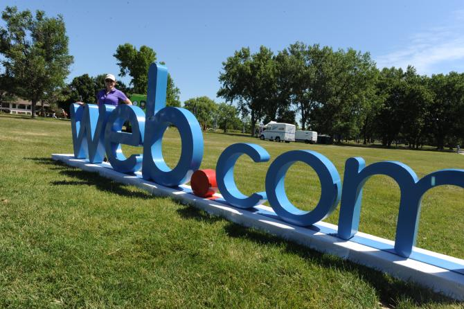 "A large, 3D sign reading ""web.com""sits on the ground at the golf course"