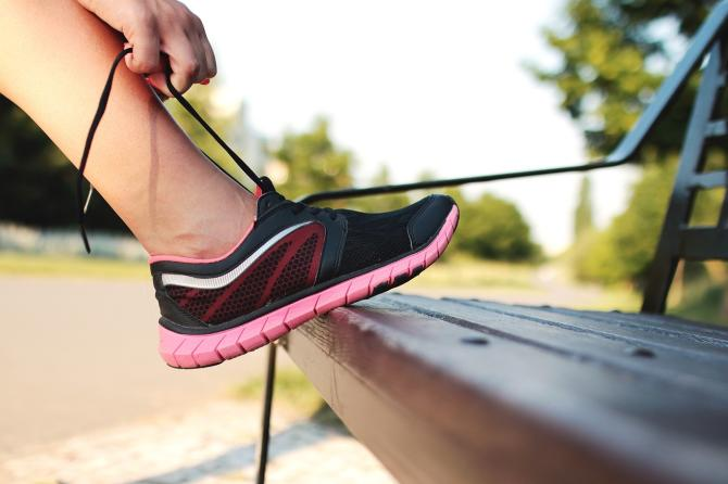 A runner ties her new running shoes before a race in Wichita