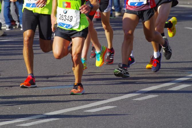Photo of runners in a 5k or marathon during a sunny day in Wichita.