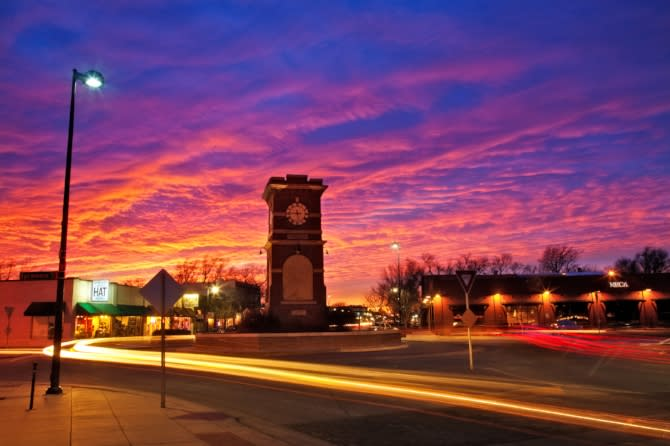 Historic Delano District in Wichita KS at Sunset with pink, orange and purple sky courtesy Mickey Shannon