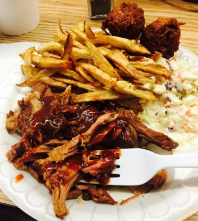 BBQ meat, french fries, hush puppies and coleslaw from Love That BBQ