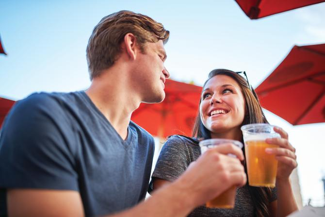 A man and woman enjoy beers on a patio in Wichita