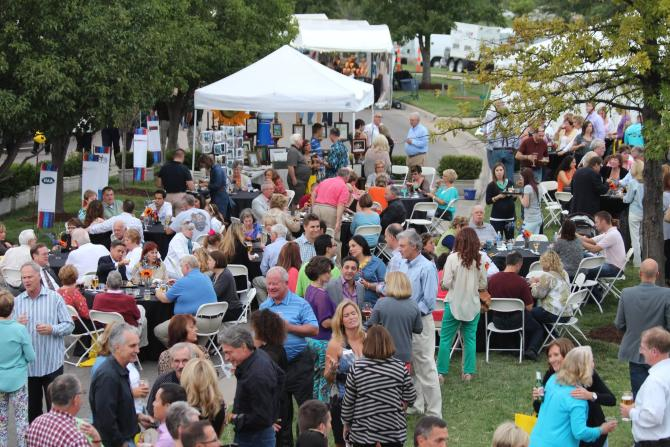 A large crowd gathers on the lawn at Bradley Fair for the Autumn & Art Festival in Wichita