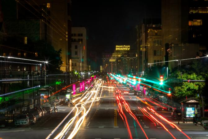 A long-exposure shot of westbound Douglas Ave in Downtown Wichita