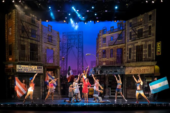 A stage-full of performers finish a scene set in the city at Music Theatre Wichita