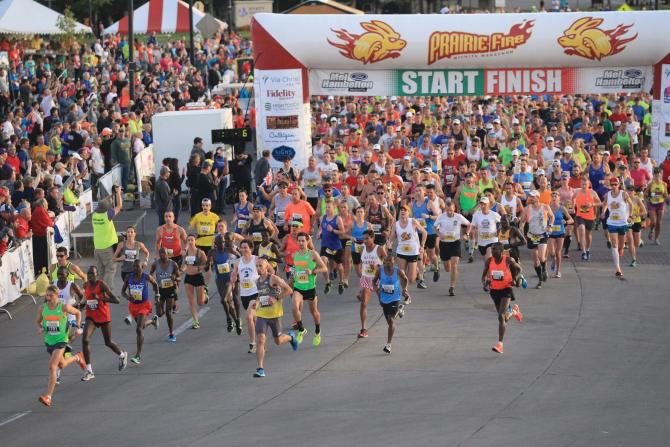 The Prairie Fire Marathon begins with a large number of runners leaving the starting line