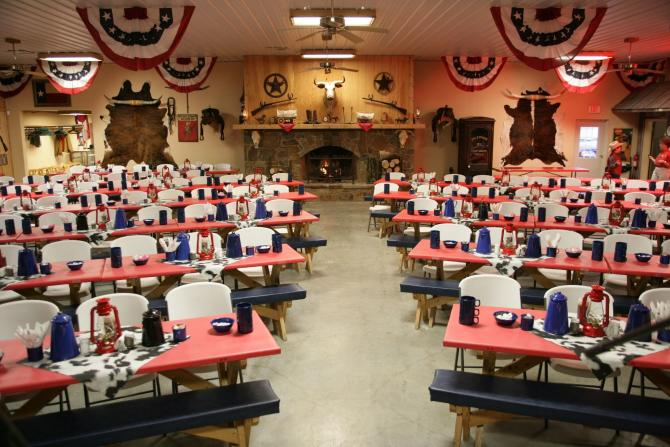 The dining room at Prairie Rose decorated in red, white, and blue for Independence Day