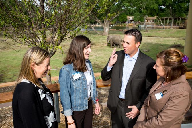 Meeting planners gather in front of the elephant display at the Sedgwick County Zoo in Wichita, Kansas