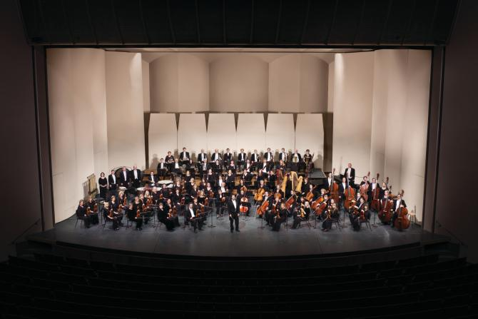 Wichita Symphony hold their instruments on stage before a performance