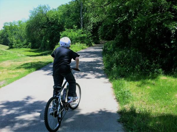 Ohio River Greenway, boy on bike