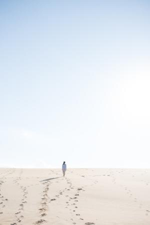A woman enjoys the wide open spaces of Jockey's Ridge State Park in North Carolina.