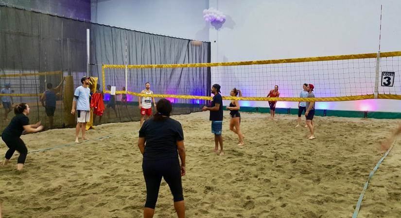 Two teams play beach volleyball at 6Pack Indoor Beach