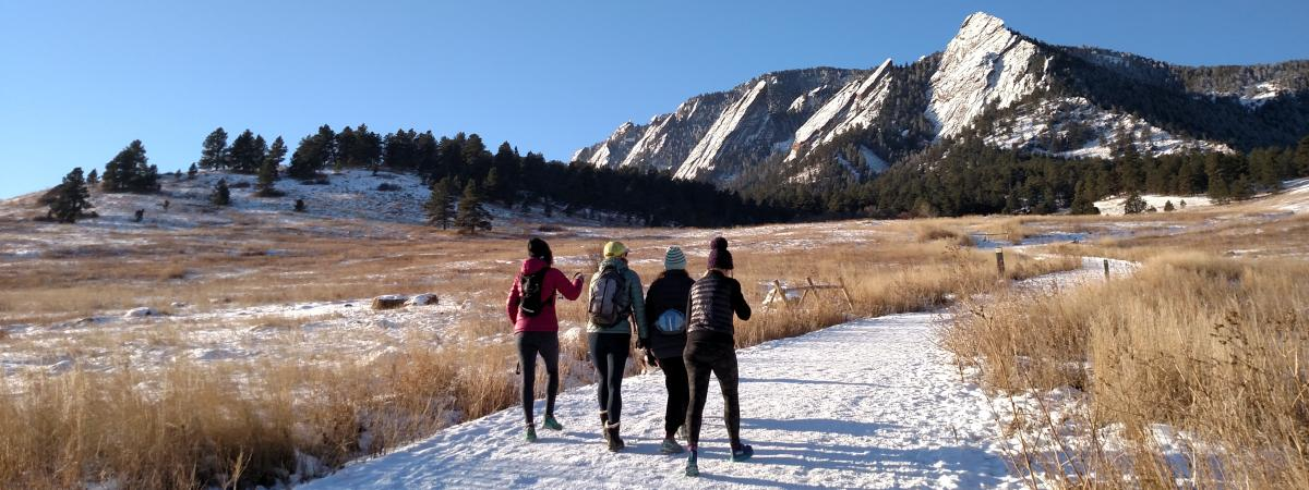 Wintertime hiking group in Flatirons in Boulder, CO
