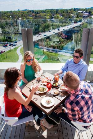 Two couples dining on the rooftop patio at VASO