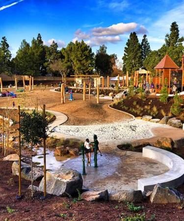 Children play at Adventure Playground, located at University Park in central Irvine.