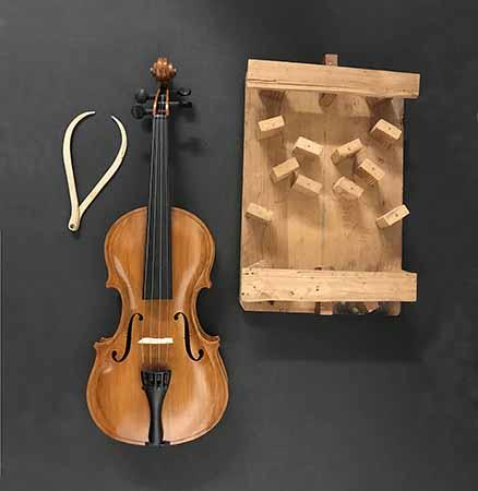 Conscientious objector Howard Scott created the parts for this violin by hand using wood scraps found during his incarceration at McNeil Island during World War II.