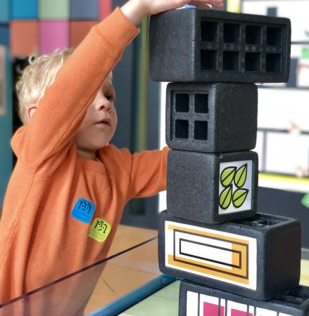 Building a block tower at Manitoba Children's Museum