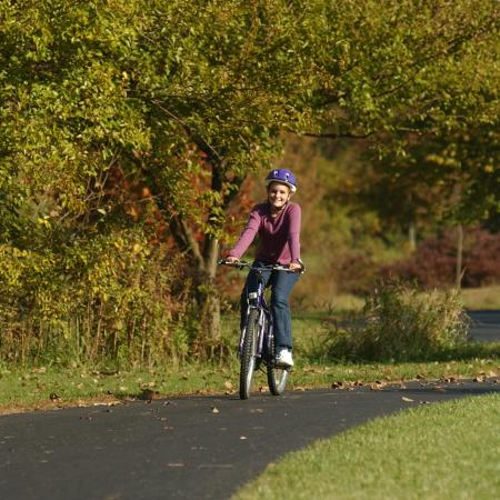 Young girl riding bike on trails in Dublin, Ohio.