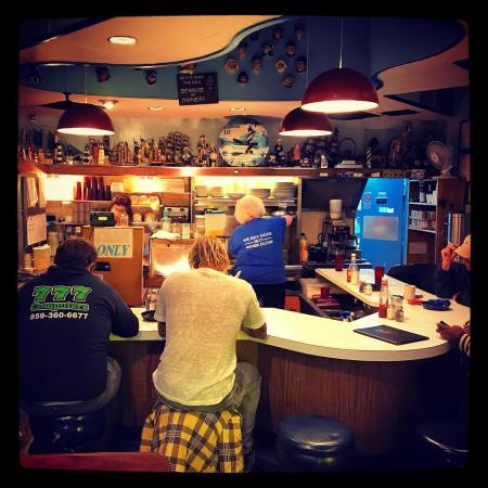 picture of two men sitting on stools in the anchor grill, a diner in covington kentucky