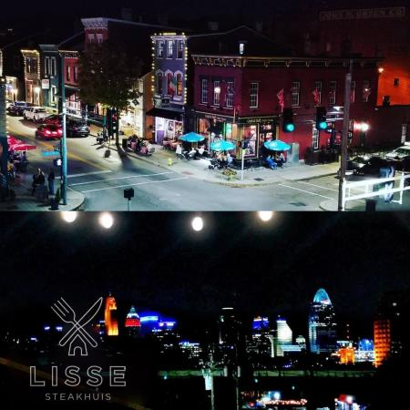 Shows two night views from Lisse restaurant, one of Mainstrasse Covington, Ky and one of the Cincinnati Skyline and Ohio River