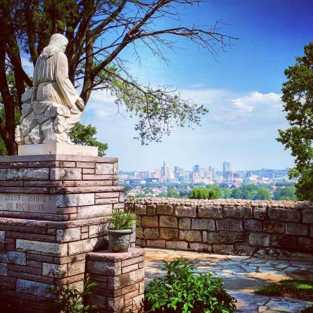 photo of statue at garden of hope in covington ky with views of the cincinnati oh skyline